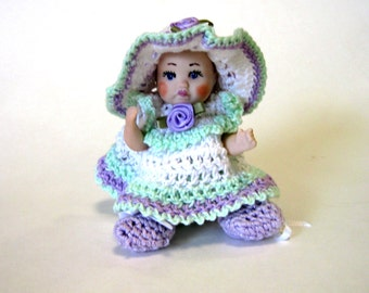 "Doll baby 4 "" handcrafted all porcelain dressed in crocheted dress"