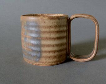 Beige and Black Mug