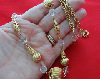 """Vintage 30"""" gold tone necklace with glass crystal accents in great condition, appears unworn"""