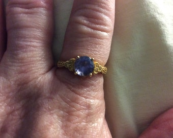 Graduation Day special an 18 Kt Yellow Gold AA Tanzanite and yellow sapphire ring size 7
