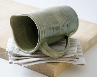 Large straight sided pouring jug - glazed in olive green