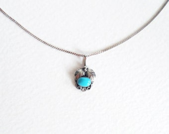 Vintage Navajo turquoise and sterling silver charm necklace
