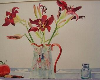 Daylilies and a Tomato