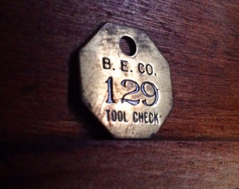 Vintage Brass B. E. Co. Tool Check Tag. Number 129.  Industrial Craft Supplies.