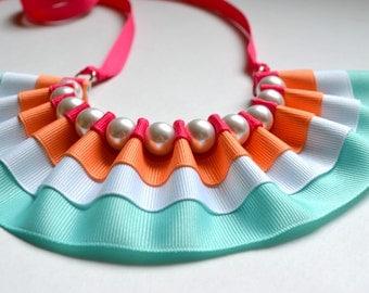 Maeve Pearls and Stripes Bib Statement Necklace. Ribbon Necklace. Ruffles. Ribbon Necklace. Pearls. Twillypop. Fall Fashion