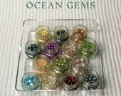 Freshwater pearls, beads, beads in containers