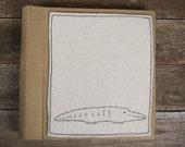 handmade linen album with hand-embroidered wool felt patch: crocodile by kata golda