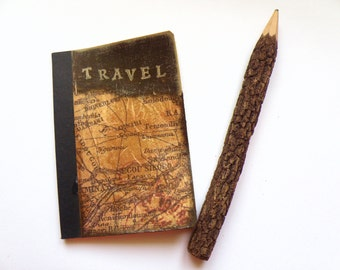 Pocket travel journal with decoupage of Asia's map