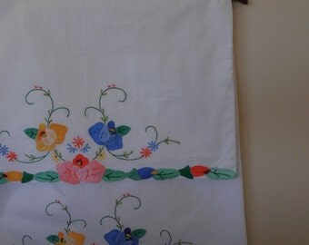 pair of vintage cotton pillowcases with applique and embroidery