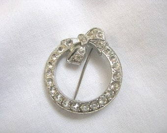 Vintage round metal wreath brooch pin with rhinestone accents and bow
