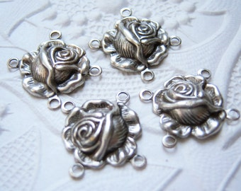 4 - Antiqued  silver plated rose connectors-  EO135