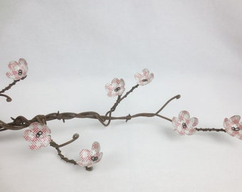 Beautiful Rusty Barbed Wire Limb With Cherry Blossoms