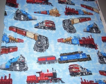 Trains on light blue -  Cotton Fabric - 15 inches wide and sold by the yard