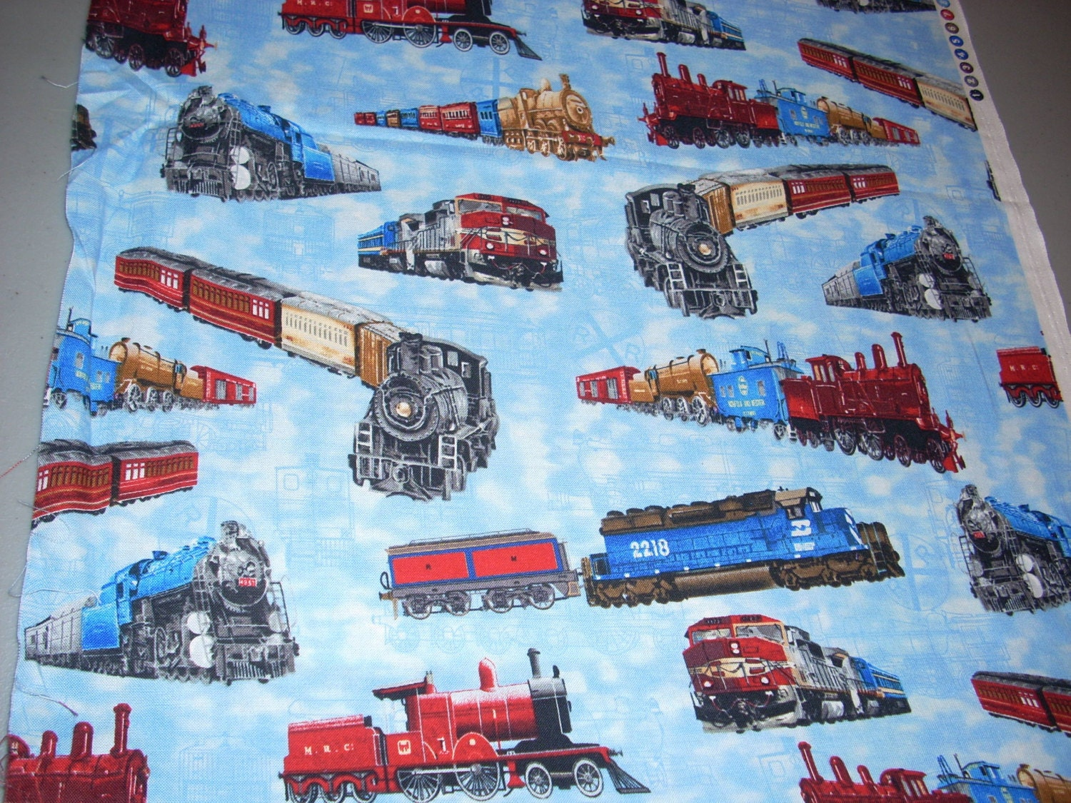 Trains on light blue cotton fabric 15 inches wide by for Train print fabric