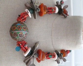 Vintage original Moroccan Berber jewelry necklace, fossil amber, egg bead, silver, coral, pendants, shell and old trade beads..