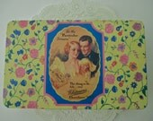 Whitman's Chocolates vintage DECORATIVE TIN - lovers, floral, yellow, pink, hinged lid, gold