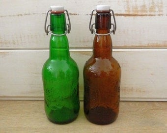 A Pair of Vintage Grolsch Bottles - Green and Amber Glass