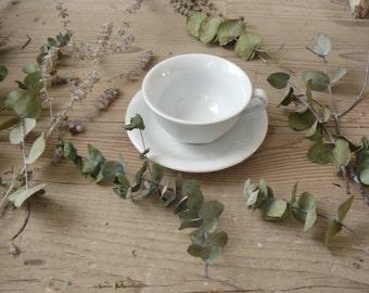 Vintage white tea cup. Ceramic tea cup. Cappuccino cup