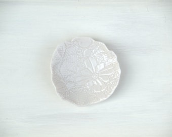 White ceramic ring dish.  Free form porcelain trinket tray or spoon rest with floral pattern. Handmade ceramic ring dish.