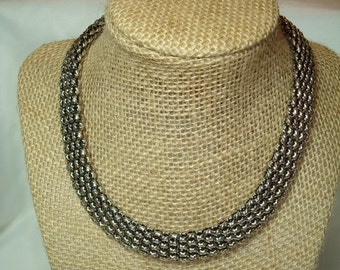 1992 Wide Woven Silver Tone Choker with Gold Tone Magnetic Clasp.