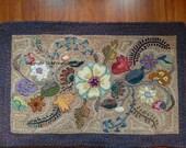 NEW PATTERN-Deco Garden hooked rug pattern on linen foundation