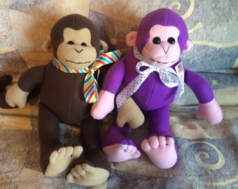 Cute and cuddly stuffed monkey in brown or purple