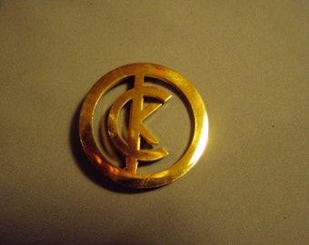 Vintage 1980s Calvin Klein Yellow Gold Tone Round Pin With CK Initials in Design 8503
