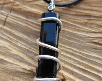 Black Tourmaline Pendant...Night Bird features a beautiful piece of Black Tourmaline that is Spiral wrapped in Silver.