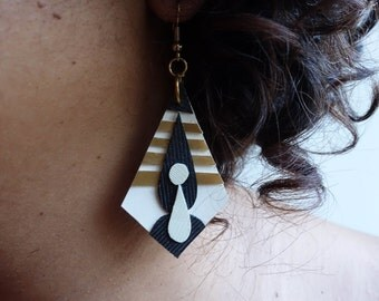 Hand cut diamond hung geometric x gold and ivory polyurethane earrings