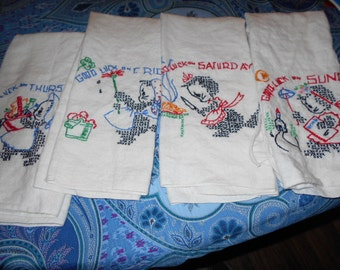 Four Vintage  hand embroidered day of the week towels