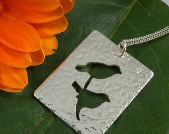 Silver Birds pendant: A beautiful textured silhouette of two love birds on a branch in sterling silver.