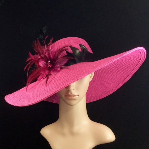That's true (and magnified by ) on Derby Day. If your dress is more muted, opt for bold-colored accessories, like a hot pink organza hat! 4. Black and White Sheath Dress and Black Floppy Hat. If you don't want or have time to find a custom-made Derby hat or order a fancy Derby .