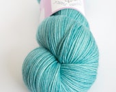 Blue-green hand-dyed fingering weight yarn   Round Table Yarns Perceval in Orkney