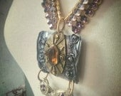 Vintage statement assemblage necklace with purple rhinestone glamour and glitz