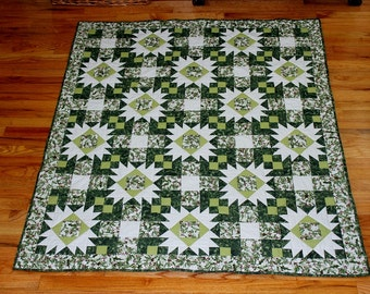 Christmas quilt throw or lap size pieced greens whites red with gold and silver highlights