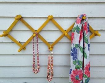 Vintage Yellow Accordion Wood Peg Rack