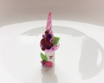 Miniature fairy house in pink and purple handmade from polymer clay