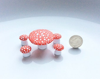 Quarter scale dollhouse toadstool table and stools hand made from polymer clay