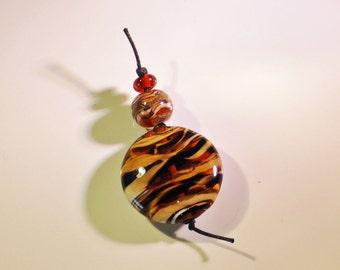 Tiger lampwork lentil