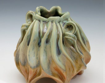 Carved porcelain gourd vessel in green, tan & orange