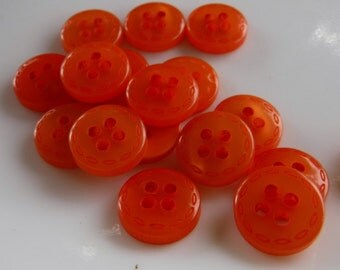 "13 Orange Stitched Edge Extra Small Round Buttons Size 7/16""."