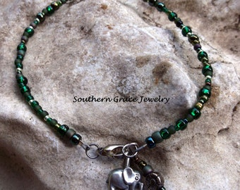 Emerald beaded ankle bracelet with silver elephant charm