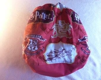 SassyCloth one size pocket diaper with Harry Potter crest on red cotton print. Made to order.