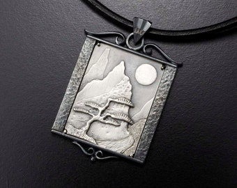 The moon and a pine tree silver pendant