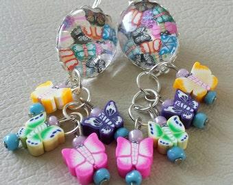 Sale was 17 now 15 uk Silvertone Oval Butterfly Leverback earrings with Butterfly dangles.
