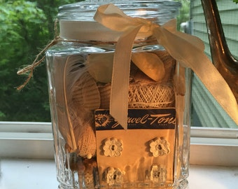 Vintage 60s apothecary candy jar filled with little treasures in shades of white tan wood spools shells buttons lace photos #1 of 4
