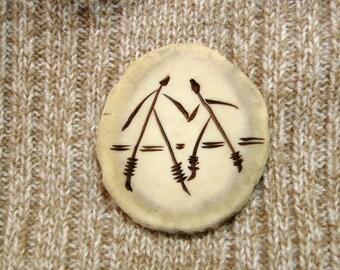 Large antler button with carved Stickmen design