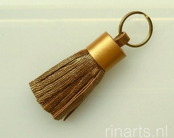 Tassel keychain / tassel keyring / fringe keychain in metallic gold goatskin and gold painted veg tanned top.