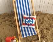 Miniature Beach Scene With A Blue Striped Beach Chair, A Nautical Throw Pillow, And A Bucket Filled With Shells