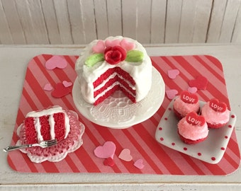 "Miniature Valentine Cake - Red Velvet W/ A Rose And Pink Hearts, A Cake Stand, A Slice Of Cake, And A Plate Of ""LOVE"" Cupcakes"
